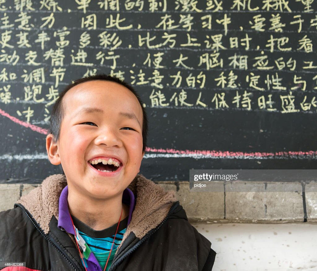 Chinese School boy, looking at camera, cheerful : Stockfoto