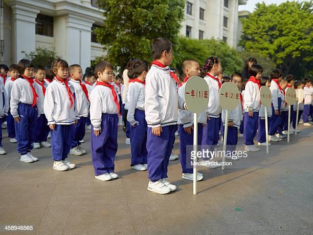 chinese school children - sportuniform stockfoto's en -beelden