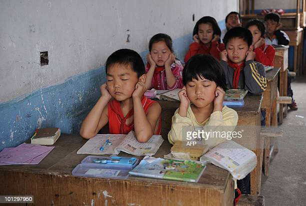 Chinese schoolchildren attend a class at a rural elementary school in Hefei central China's Anhui province on May 12 2010 The latest deadly school...