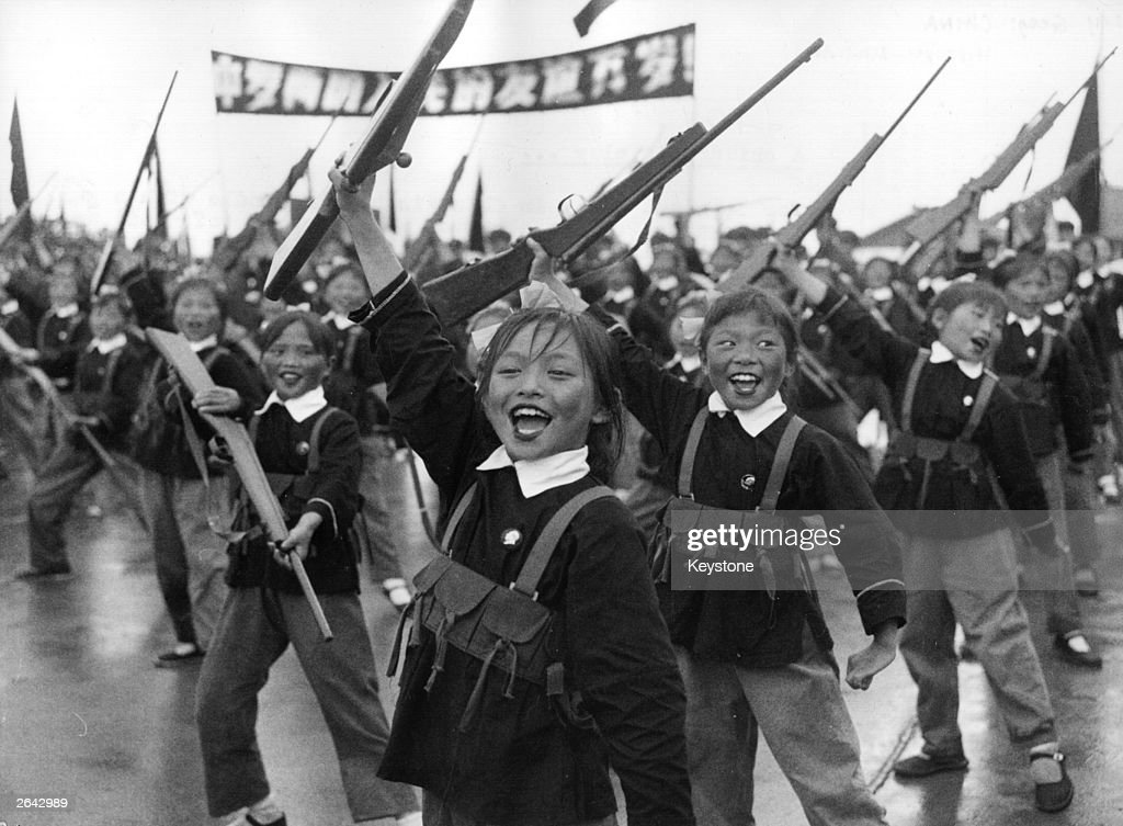 Chinese schoolchildren give a demonstration of their military skills in Hanking, where lessons include pre-military exercises using wooden weapons.
