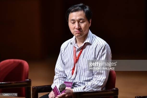 Chinese scientist He Jiankui reacts during a question and answer session after speaking at the Second International Summit on Human Genome Editing in...