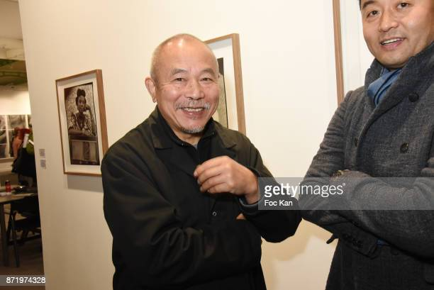 Chinese Sculptor Wang Keping and chinese photographer/artist Liu Bolin attend Paris Photo 2017 Preview at Grand Palais on November 8 2017 in Paris...