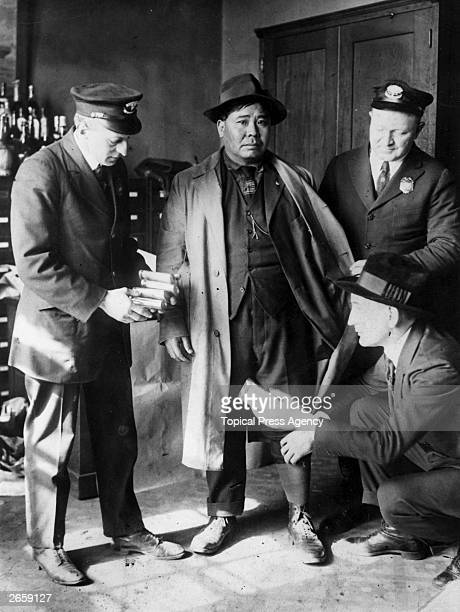 A Chinese seaman being arrested at the port of New York for the attempted smuggling of opium