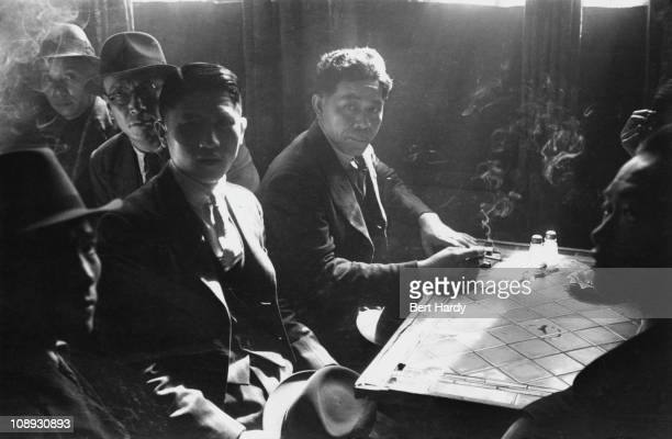 Chinese seamen at a Chinese hostel in Liverpool, May 1942. Original publication: Picture Post - 1136 - Chinese Hostel, Liverpool - unpub.