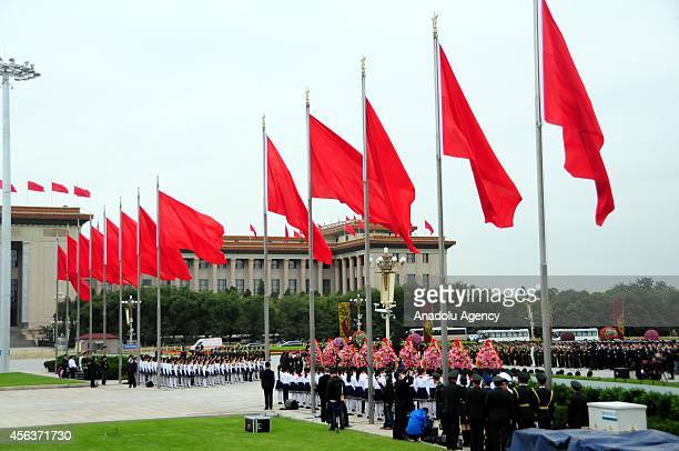 Chinese security forces' members and children during the commemoration ceremony for the first Martyrs' Day at the People's Heroes Monument in...