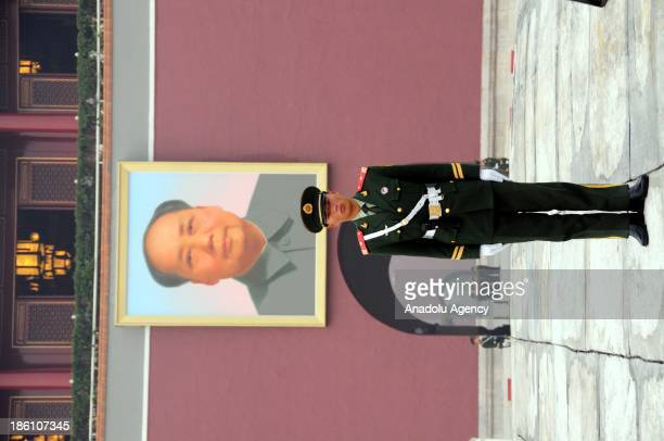 Chinese security guard stands guard at the Tianamen Square Beijing on October 28 2013 5 people died and 38 injured on a car crash after a car...