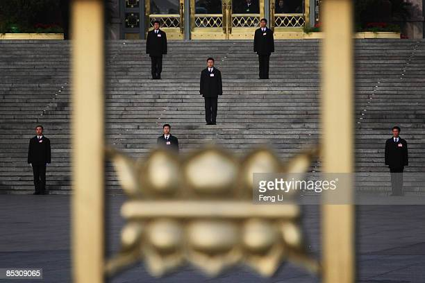 Chinese security guards stand at the main entrance of the Great Hall of the People during a plenary session of the annual National People's Congress...