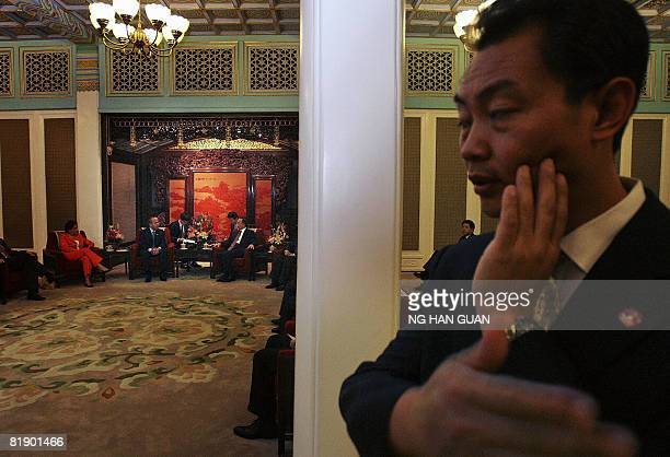 A Chinese security personnel looks on as Mexico's President Felipe Calderon meets with Chinese Premier Wen Jiabao at the Zhongnanhai compound in...