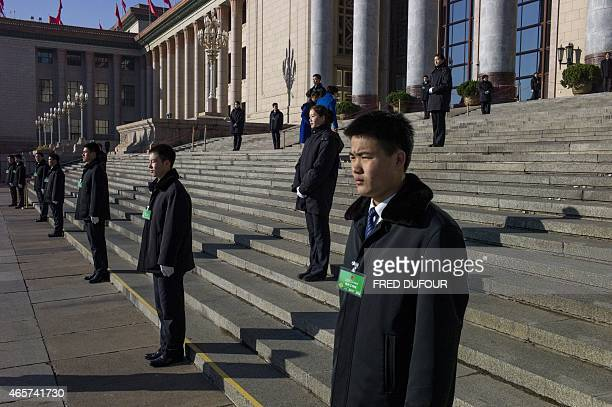 Chinese security stand outside the venue of a plenary session of the Chinese People's Political Consultative Conference an advisory body to the...