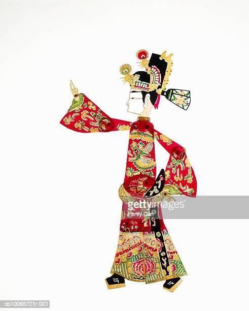 chinese shadow puppet on white background - shadow puppet stockfoto's en -beelden