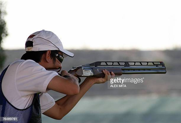 Chinese shooter Binyuan Hu prepares to fire during the double trap final competition of the first day of the ISSF World Shooting Championships held...