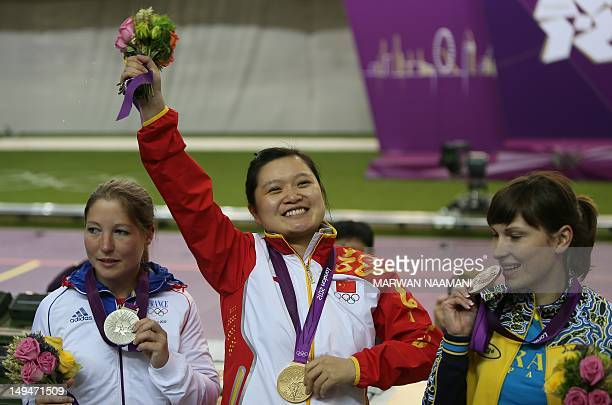 Chinese shooter Guo Wenjun winner of the gold medal of the women's 10m Air Pistol at the London 2012 Olympic Games celebrates along with silver...