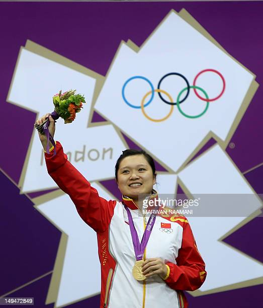 Chinese shooter Guo Wenjun winner of the gold medal of the women's 10m Air Pistol at the London 2012 Olympic Games waves to the crowd as she stands...