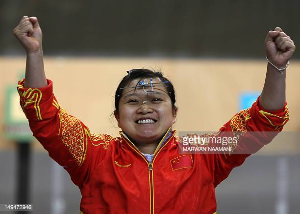Chinese shooter Guo Wenjun winner of the gold medal of the women's 10m Air Pistol at the London 2012 Olympic Games celebrates her victory at The...