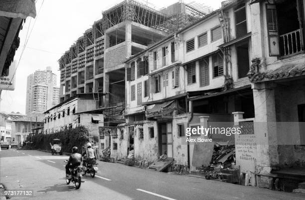 Chinese shophouses on Craig Rd fall victim to urban renewal during the construction of Chinatown Plaza Chinatown Singapore 12 July 1983 The September...
