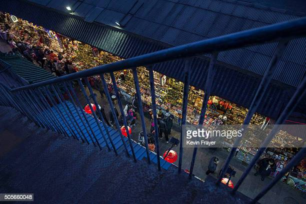 Chinese shoppers walk through a market below on January 19 2016 in Beijing China In 2015 China's economy grew at its slowest rate in a quarter...