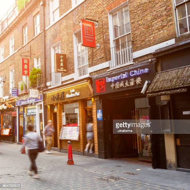 chinese shops and restaurants in soho london - west end london stock photos and pictures