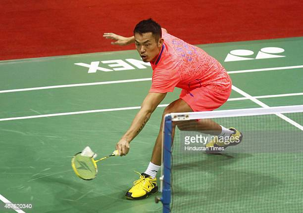 Chinese shuttler Lin Dan in action against HU Yun of Hong Kong during the mens pre-quarterfinal of Yonex Sunrise India Open Badminton tournament at...