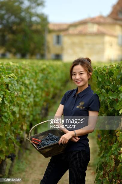 Chinese singer and actress Zhao Wei poses on September 18 2018 in SaintHippolyte southwestern France in her vineyard of Chateau Monlot which is being...