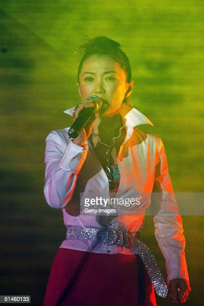 Chinese singer Chen Lin performs during music and light artist Jean Michel Jarre's concert in Tiananmen Square for the official launch of the Year of...