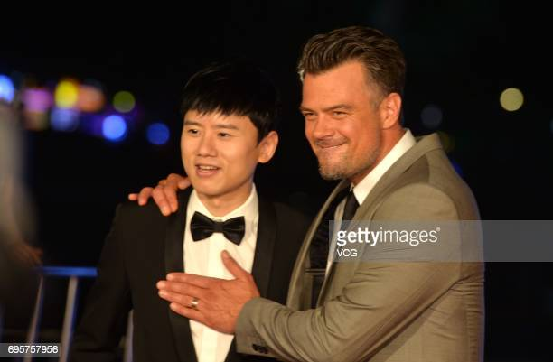 Chinese singer Jason Zhang Jie and American actor Josh Duhamel attend the premiere of American director Michael Bay's film 'Transformers The Last...