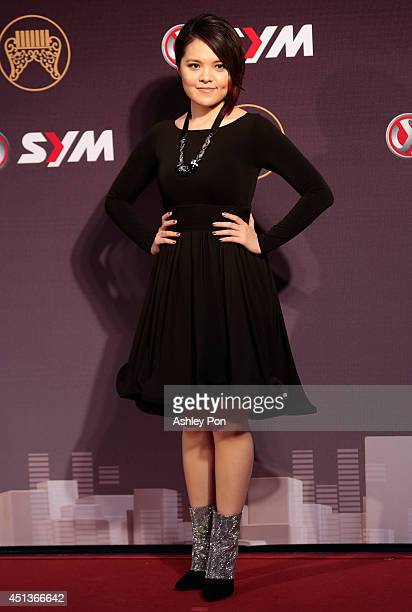 Chinese singer Koala arrives at the 25th Golden Melody Awards on June 28 2014 in Taipei Taiwan The Golden Melody awards in the annual Taiwanese music...