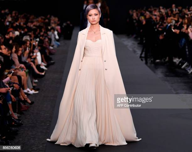 Chinese singer Li Yuchun takes part in the L'Oreal fashion show which theme is Paris on the sidelines of the Paris Fashion Week on a catwalk set up...