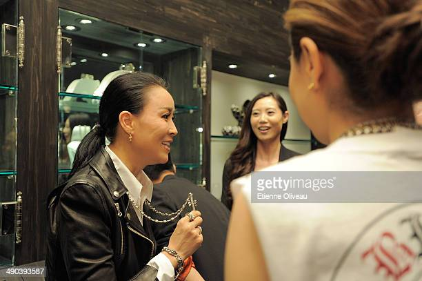 Chinese Singer Na Ying tries on a cross necklace during the Chrome Hearts Beijing Store Opening on May 14, 2014 in Beijing, China.
