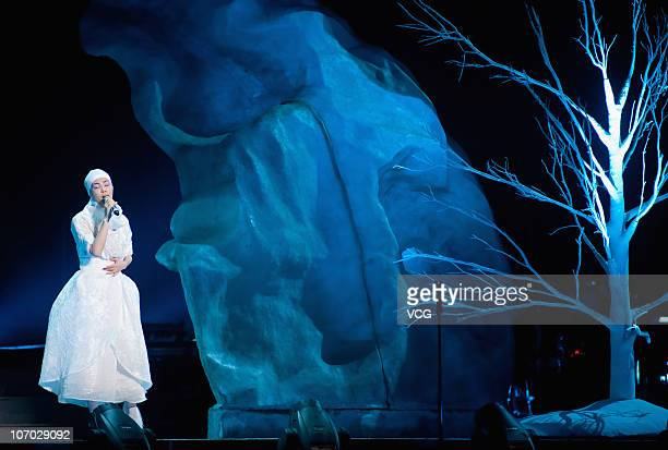 Chinese singersongwriter and actress Faye Wong performs on the stage during her concert at Shanghai World Expo Performing Arts Center on November 19...