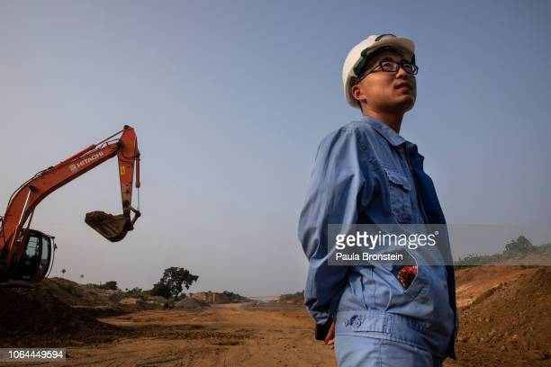 Chinese site engineer is seen on site as the extension of the Southern Expressway from Matara to Hambantota continues under construction on November...