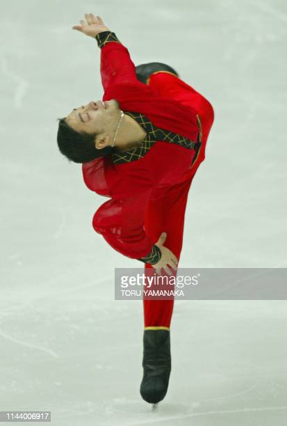 Chinese skater Li Chengjiang spins during the men's short program in the NHK Trophy figure skating competition in Kyoto, western Japan, 30 November...