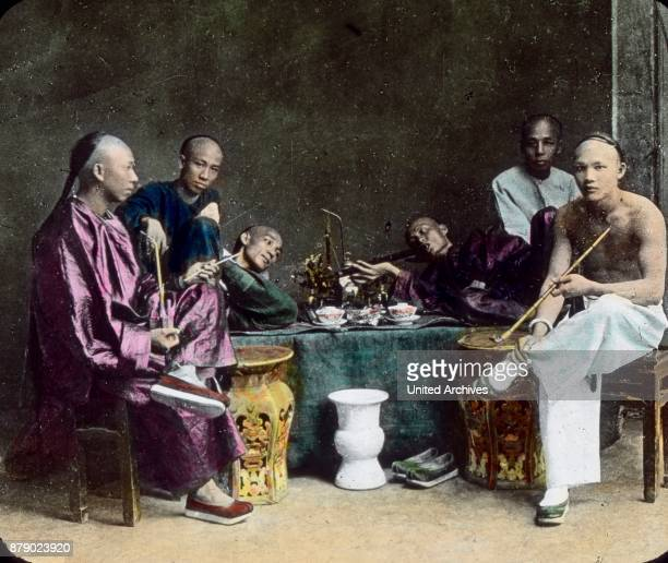 Chinese smoking in an Opium den, China.