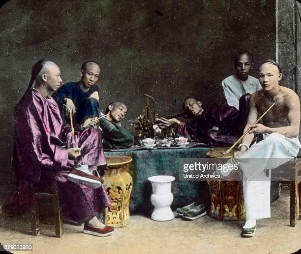 Chinese smoking in an Opium den China