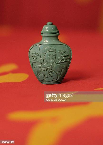 A Chinese snuff bottle depicting Lei Feng in carved tourquoise dating 196670 is pictured at Bloomsbury auction house in London on November 2 2009 The...
