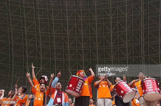 Chinese soccer fans of Shenzhen Jianlibao celebrate after the team won the 2004 Chinese Super League championship on November 24 2004 in Shenzhen...