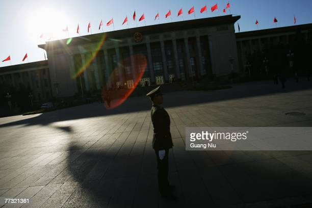 Chinese soldier guards in front of the Great Hall of the People after a preparatory meeting for the upcoming 17th National Congress of the Communist...