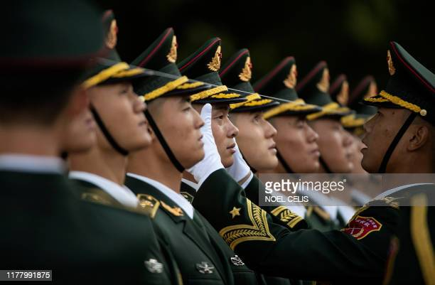 Chinese soldier has his cap aligned before taking part in a military honour guard in a welcome ceremony for Brazilian President Jair Bolsonaro...