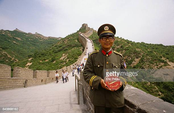 A Chinese soldier holding a tin of 'Tsar Nicoulai' caviar on the Great Wall of China The Swedish couple of Dafne formerly working in fashion and Mats...