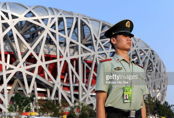 Chinese soldier stands at attention in front of the National Stadium on August 5 2008