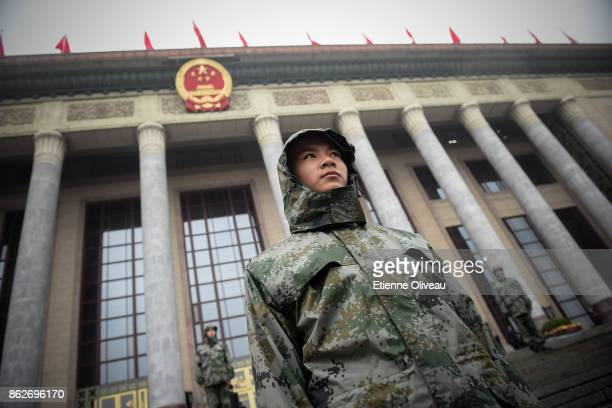 Chinese soldier stands guard outside the Great Hall of the People during the opening session of the 19th Communist Party Congress held at the Great...