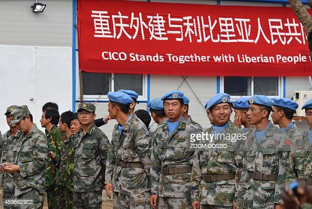 Chinese soldiers and army's medical team attend an opening ceremony of a Chinese 100bed ebola treatment center in Monrovia on November 25 2014 A...