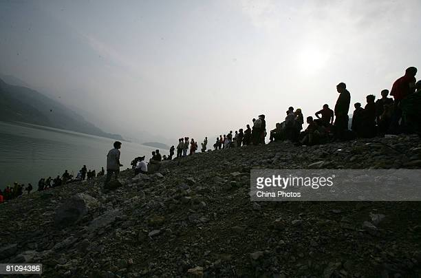 Chinese soldiers and doctors wait to rescue earthquake survivors at the Zipingpu Dam on May 15 2008 in Dujiangyan of Sichuan province China A major...