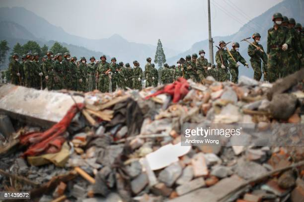 Chinese soldiers arrive to clean up an area ruined by the May 12 earthquake on June 5, 2008 in Shifang, Sichuan province, China. More than 69,000...