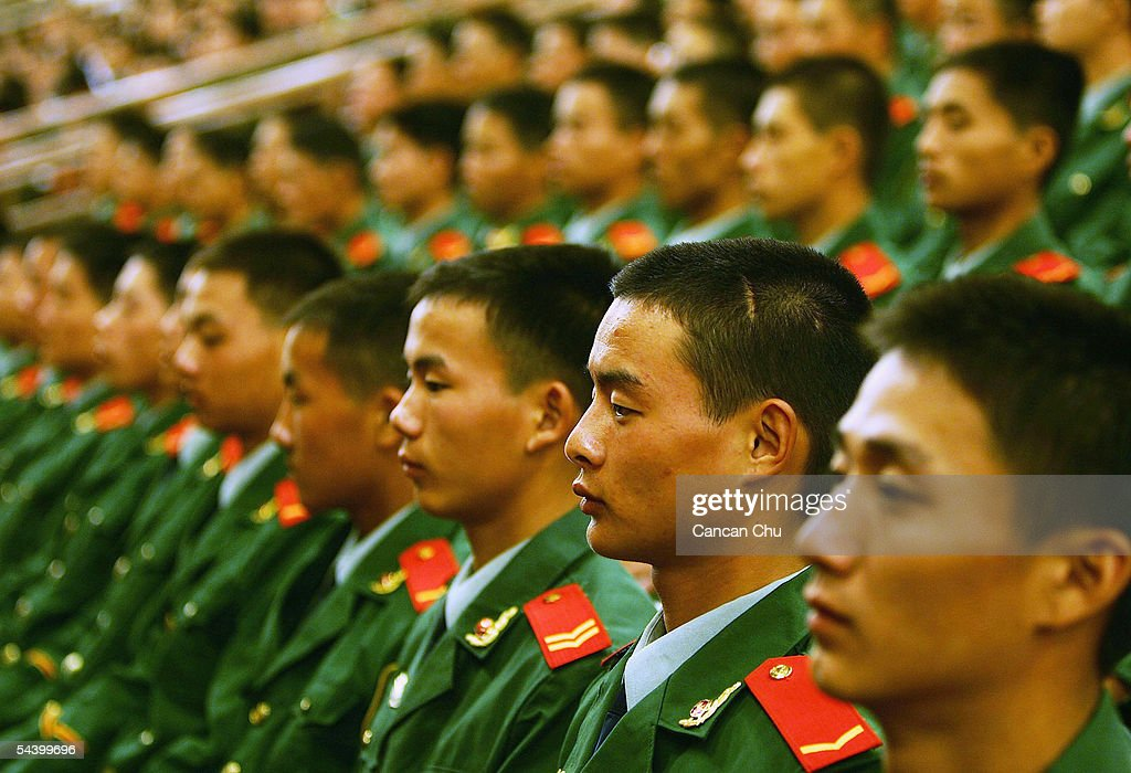 Chinese soldiers attend a meeting marking the 60th anniversary of the victory of China's Resistance War Against Japanese Aggression September 3, 2005 in Beijing, China.