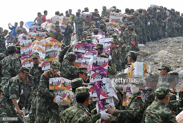 Chinese soldiers carry aid at Zipingpu Dam in China's southwestern province of Sichuan on May 16 2008 after an earthquake measuring 79 rocked the...