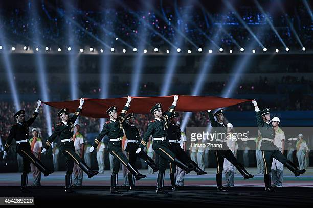 Chinese soldiers carry the national flag during the Closing Ceremony of Nanjing 2014 Summer Youth Olympic Games at the Nanjing Olympic Sports Centre...