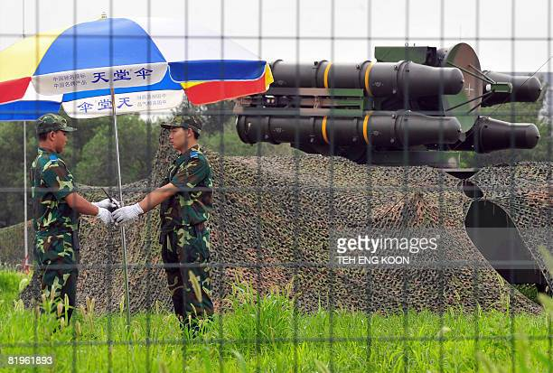 Chinese soldiers change shifts in front of surfacetoair missile launchers at a military administrative area near the Olympic Green on July 17 22 days...