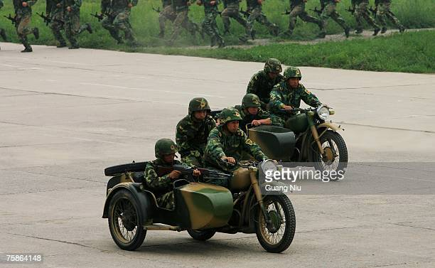 Chinese soldiers from the People's Liberation Army 196th Infantry Brigade demonstrate their military skills at their barracks on July 30 2007 in...