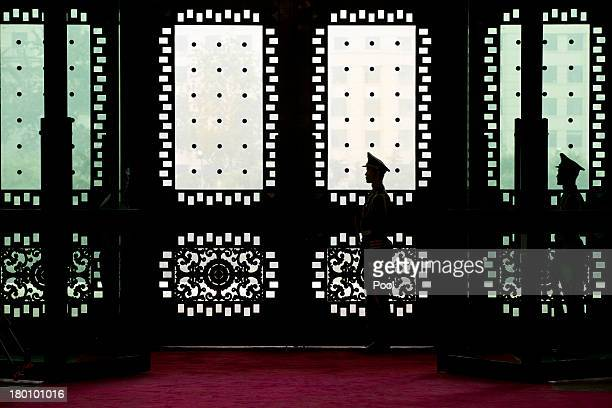 Chinese soldiers guard inside the gate of Chinese Defense Ministry's Bayi Building while James Miller US Under Secretary of Defense for Policy is...