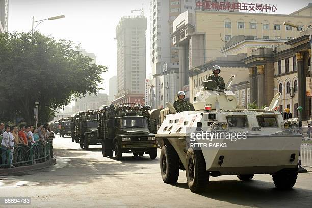 Chinese soldiers in an APC drive on the streets of Urumqi in China's far west Xinjiang province on July 8 2009 China poured troops into the restive...